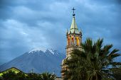 stock photo of andes  - Volcano El Misti overlooks the city Arequipa in southern Peru - JPG