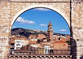 foto of aqueduct  - View of the Los Arcos Aqueduct with town buildings to the rear Teruel Teruel Province Aragon Spain Western Europe - JPG