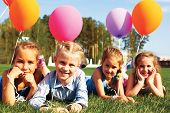 image of helium  - Group of happy kids with balloons on the street