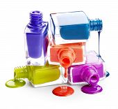 stock photo of nail paint  - Bottles With Spilled Nail Polish isolated on white background - JPG