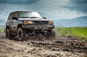 stock photo of dirt road  - Off road vehicle splashed mud - JPG