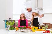 foto of pupils  - Chef master and junior pupil kid girls at cooking school with food on countertop - JPG