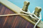 stock photo of nautical equipment  - Marine rope tied into knot in foreground white background - JPG