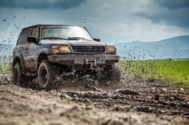 pic of recreational vehicle  - Off road vehicle splashed mud - JPG