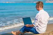 stock photo of deserted island  - Lost businessman working on a deserted island