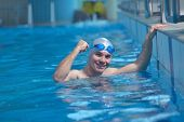 image of swim meet  - health and fitness lifestyle concept with young athlete swimmer recreating  on indoor olimpic pool - JPG