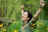pic of breath taking  - happy woman taking a breath in beautiful spring nature - JPG