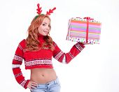 picture of antlers  - Beautiful blonde woman with reindeer antlers holding gift - JPG