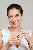 young woman using nail polish poster