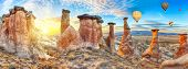 stock photo of fairy-mushroom  - Rocks looking like mushrooms dramatically lit by a sunset in Cappadocia - JPG