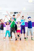 picture of zumba  - Dance teacher giving children Zumba fitness class in gym - JPG