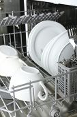 foto of dishwasher  - Open dishwasher with clean utensils in it - JPG