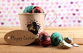 picture of bird egg  - Bird colorful eggs in mug on bright background - JPG