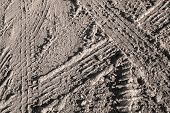 image of dirt road  - Background texture of dark brown road dirt with tire tracks - JPG