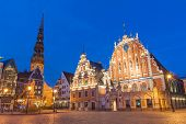 pic of reconstruction  - Famous House of Blackheads on the Town Square in Riga with a Church of St - JPG
