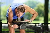 foto of fountains  - Sport man drinking water from public park fountain - JPG