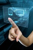 stock photo of transfer  - a woman finger transfer data on a digital screen - JPG