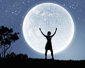 image of moon silhouette  - Silhouette of woman against full moon with hands up - JPG