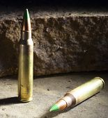 picture of piercings  - Two cartridges with green tips some consider to be armor piercing - JPG