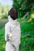 image of rapier  - Fencer woman staying over beautiful nature background with rapier - JPG