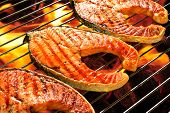 foto of flame-grilled  - Grilled salmon on the flaming grill - JPG