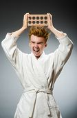 stock photo of karate  - Funny karate fighter with clay brick - JPG