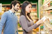 pic of supermarket  - Couple shopping in a supermarket - JPG
