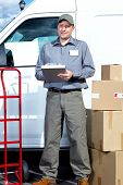 foto of postman  - Postman with parcel box - JPG