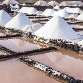 stock photo of salt mine  - salt piles in the saline of Janubio in Lanzarote - JPG