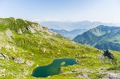 picture of italian alps  - High altitude blue lake in idyllic uncontaminated environment once covered by glaciers - JPG