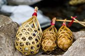 pic of quail  - Quail eggs in round bamboo basket boil on hot spring - JPG