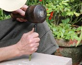 pic of chisel  - A Stonemason Engraving with a Hammer and Chisel - JPG