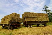 pic of hayride  - Large bales of straw on a tractor trailer - JPG