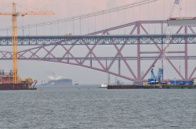 picture of bridge  - Construction of the new Forth Road Bridge taken from the south shore with the original road bridge and the rail bridge in the background - JPG