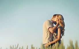 picture of tariff  - stunning sensual young couple in love posing in summer field happy lifestyle concept - JPG