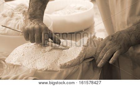 Man Cuts The Cheese Freshly Prepared