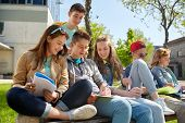 education, high school and people concept - group of happy teenage students with notebooks learning  poster