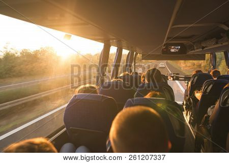 poster of Background. Travel By Bus. Bus Interior. Salon Of The Bus With People Fill The Sun With Light In The