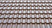 Tile Roof Background And Texture. Pattern Of The Wet Tiles Roof Of House. poster