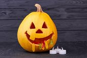 Funny Halloween Pumpkin On Dark Background. Halloween Pumpkin With Jelly Worms In Mouth, Funny Jack. poster