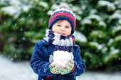 Cute Little Funny Kid Boy In Colorful Winter Fashion Clothes Having Fun And Playing With Snow, Outdo poster