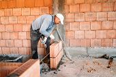 Bricklayer Industrial Worker Installing Brick Masonry On Interior Wall With Trowel Putty Knife poster