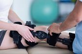 Close-up On Person With Stiffener On The Leg During Rehabilitation With Physiotherapist poster