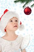 stock photo of starlet  - baby in santa claus christmas red hat and snowflake and starlet - JPG