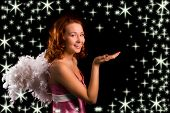 image of starlet  - angel in pink on black background with starlet - JPG