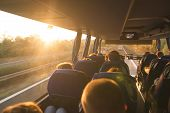 Background. Travel By Bus. Bus Interior. Salon Of The Bus With People Fill The Sun With Light In The poster
