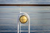 Nautical White Outdoor Deck Lamp With Brass Metal Fitting Aboard Cruise Ship. poster