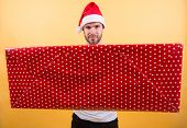 Christmas Gift Concept. Santa Bring Gift For You. Man Attractive Santa Claus Carry Big Box. You Dese poster