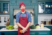 Man Chef Wear Apron Cooking In Kitchen. Man Cook Vegetarian Recipe Pepper Vegetables. Vegetarian Die poster