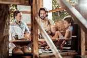 Sweet Family Of Hippies Having Lunch At Garden House poster